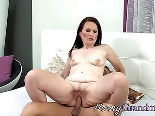 Fingered cougar takes cum