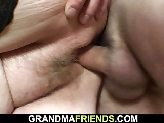 Busty office granny takes two cocks from both ends