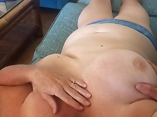 Wife relaxing while witnessing TV