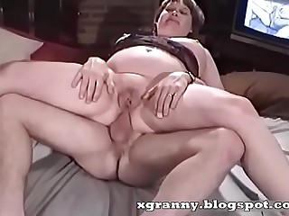 Mature puckers sit on the penis