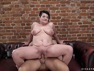 Pierced granny pussy filled with younger cock