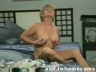 52 years Grannie Britney in her own bedroom masturbatio