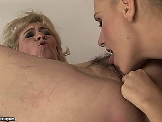GoldenHaired Legal Age Teenager And Older Lady Take Up With The Tongue Every Others Cookies