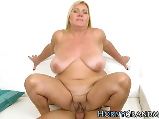 Buxom grandma gets hooter fucked