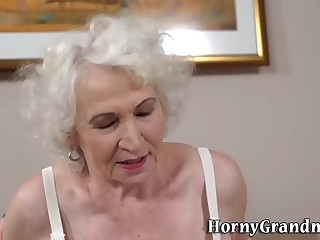 Gray haired grandmother gobbles for spunk