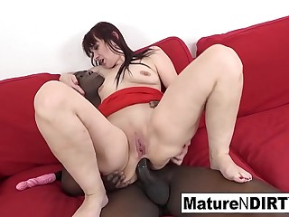 Hot dark-haired mature is craving an interracial creampie