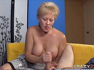 Blonde granny gives a hj