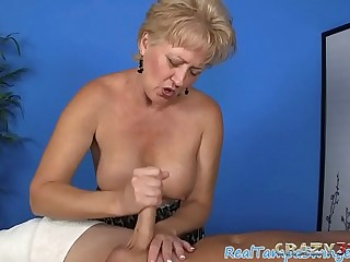 Experienced blonde slut giving a handjob