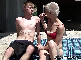 Pixie grandma guzzles young cock beneath bridge